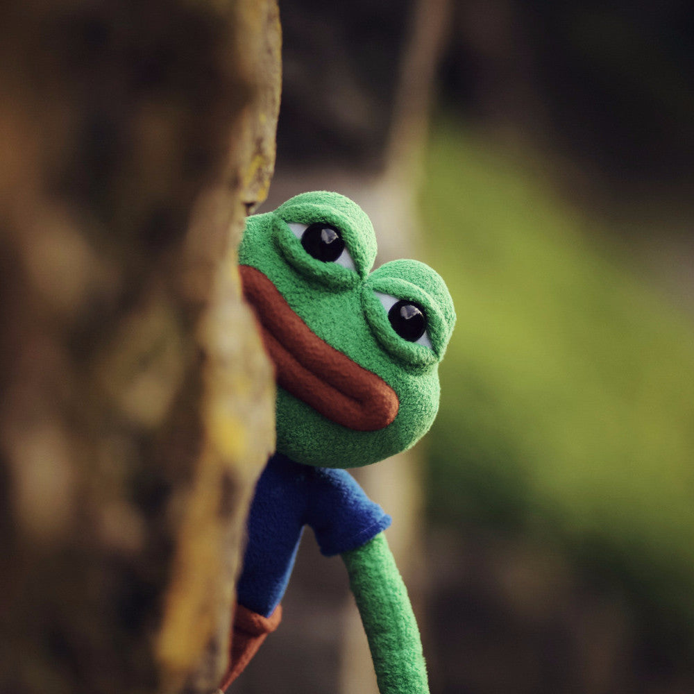 Pepe the frog creeping behind a tree