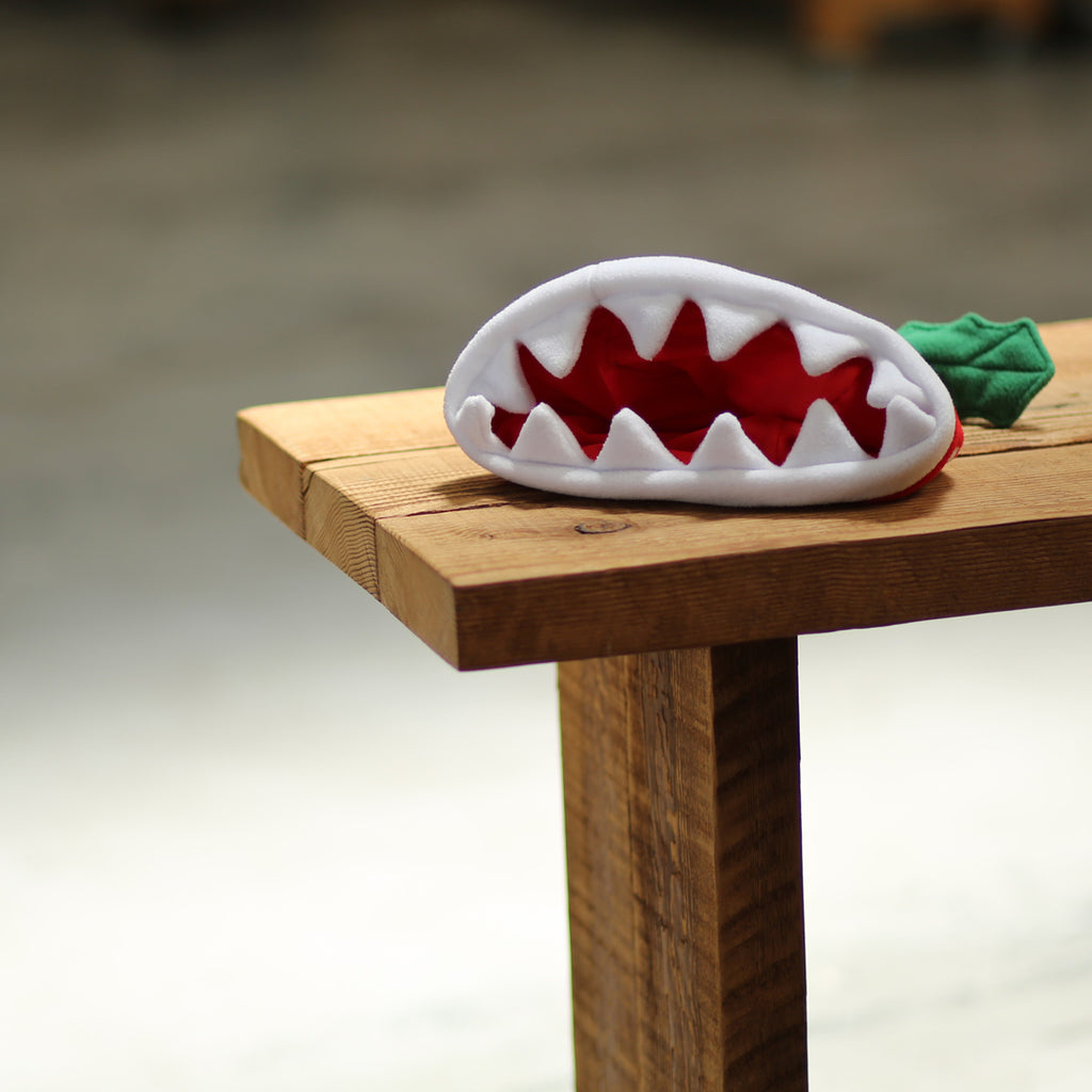 Official Nintendo product: Piranha Plant beanie (showing its jaws)