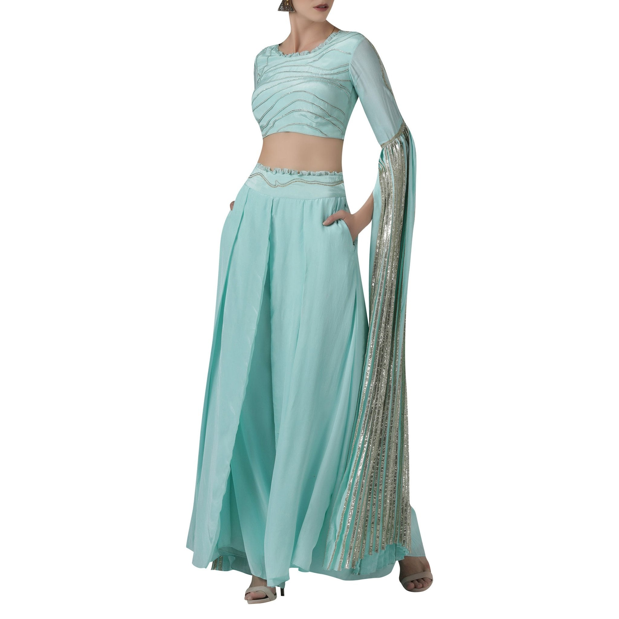 Embroidered Blouse with Exaggerated Sleeves Paired with Wide Legged Pants