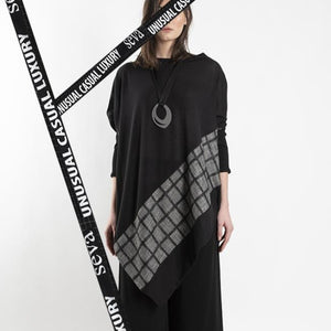 PONCHO WITH CHEQUERED DESIGN