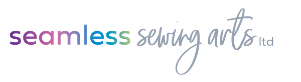 Seamless Sewing Arts has a beautiful logo with rainbow colors.