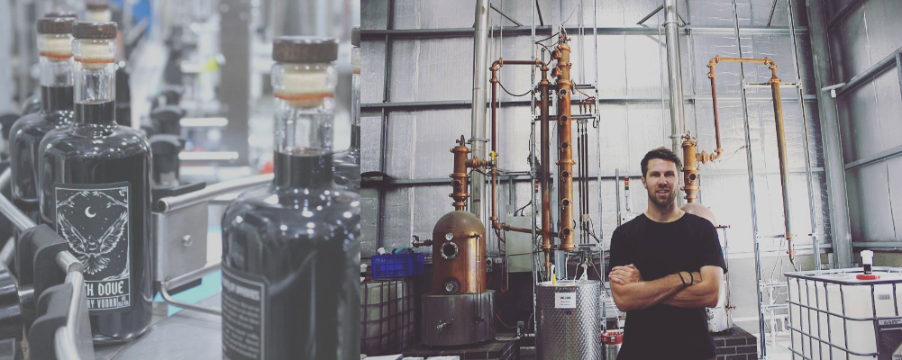 Max Norton shown with vodka production line