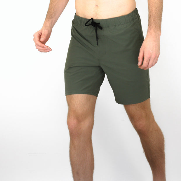 Front view of model wearing Squad Green shorts