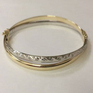 9ct YG/WG polished/dia cut crossover hinged bangle