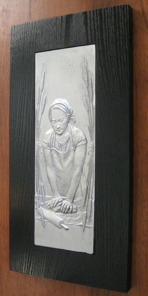 pewter relief sculpture woman bread maker kneading dough