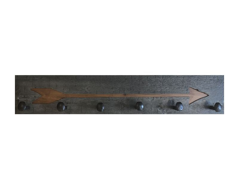Wood wall coat rack with arrow burned into the wood. Reclaimed wood and railroad spikes as hooks.