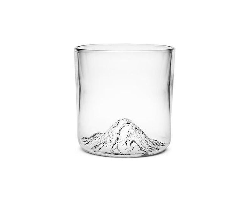 Handblown tumbler glass with Mt Rainier molded into the bottom of the glass.