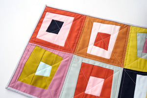 Quilted Fabric Table Runner with Colorful, Abstract Log Cabin Patchwork