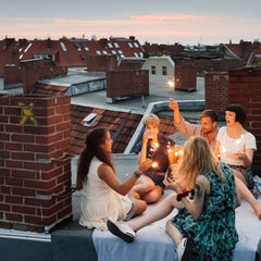 A group of people celebrating on a rooftop