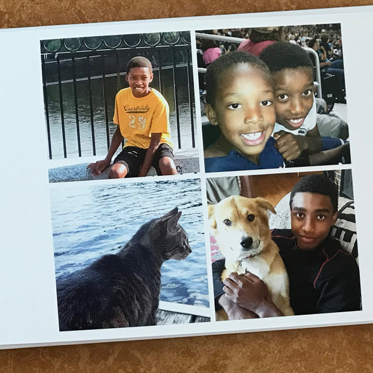 A page of a Luminta Photobook with 3 pictures of children and 1 picture of a cat