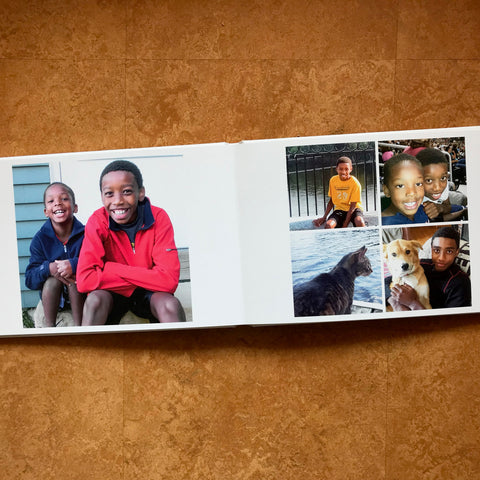 An open Luminta Photobook with pictures of children smiling