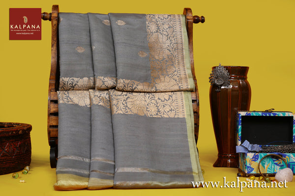 Banarsi Handloom Pure Tussar Saree with All Over Woven Motifs and Woven Zari Border. The Palla is  Woven Zari. It comes with Contrast Colored Woven Unstitched Blouse with . Perfect for Formal Wear.  Recommended for Autumn & Winter season(s). Dry Clean Only