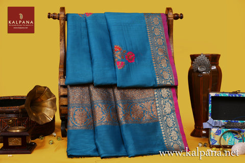 Banarsi Handloom Pure Tussar Saree with All Over Woven Motifs and Woven Zari Border. The Palla is  Woven Zari. It comes with Self Colored Tissue Unstitched Blouse with Zari Border. Perfect for Formal Wear.  Recommended for Autumn & Winter season(s). Dry Clean Only