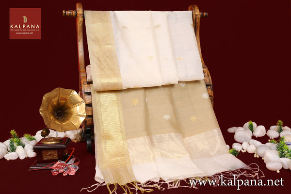 Maheshwari Handloom Pure Cotton Saree with All Over Motifs and Woven Zari Border. The Palla is  Woven Zari. It comes with Self Colored Plain Unstitched Blouse with Zari Border. Perfect for Multi Occasion Wear.  Recommended for Summer season(s). Dry Clean Only