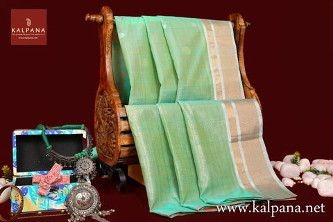 Coimbatore Handloom Pure Cotton Saree with All Over Motifs and Woven Zari Border. The Palla is  Woven Zari. It comes with Contrast Colored Plain Unstitched Blouse with Zari Border. Perfect for Semi Formal Wear.  Recommended for Summer season(s). Dry Clean Only