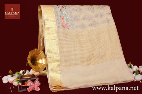 Embroidery Pure Chiffon Saree with All Over Motifs and Embroidered Border. The Palla is  Woven Zari. It comes with Self Colored Tissue Unstitched Blouse with Zari Border. Perfect for Semi Formal Wear. Embroidered Recommended for all season(s). Dry Clean Only