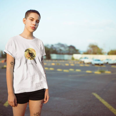 Woman wearing white shirt with bird on it