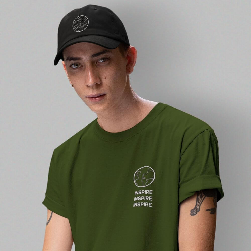 Man wearing black hat and forest green shirt that says inspire