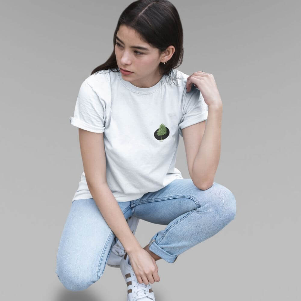 Woman wearing white shirt with tree logo