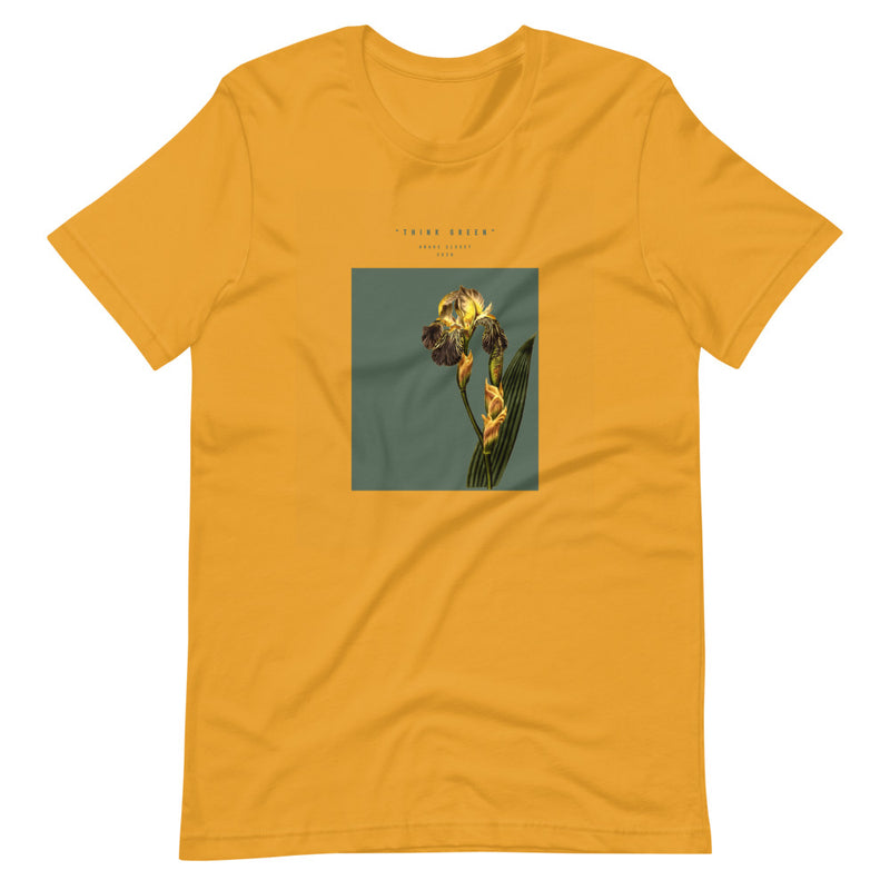 Woman sitting on ground in gold t shirt with plant graphic