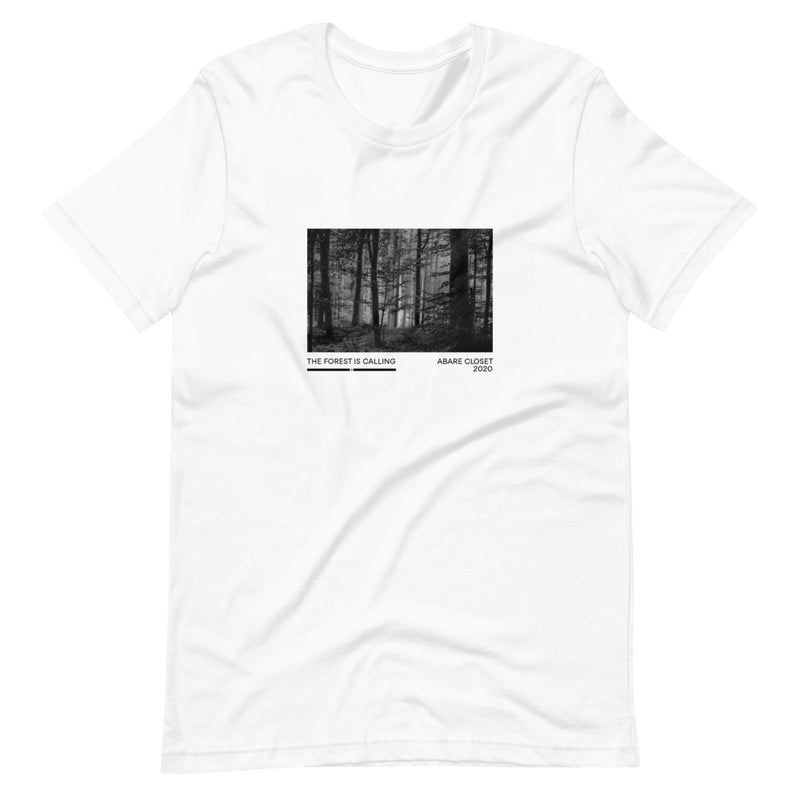 woman in the woods wearing white t shirt with forest design