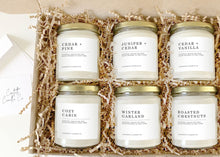Load image into Gallery viewer, cedar candles gift set, cedar + pine, juniper + cedar, cedar + vanilla, cozy cabin, winter garland, roasted chestnuts, soy candles, soy wax