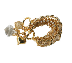 Multi strand chain link charm bracelet with a strand of round clear stones, Gold Finish