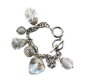 Interlocking oval link charm bracelet with dangling large size faceted stone shapes