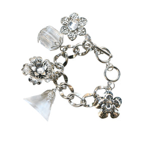 Chain link charm bracelet with dangling faceted stone charms and flowers