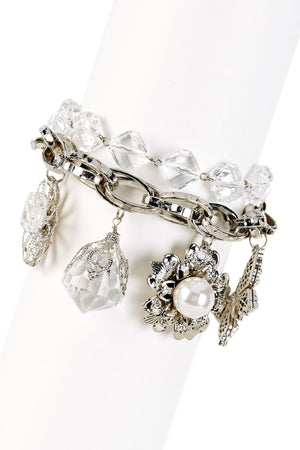 Interlocked hammered link charm bracelet with a faceted corner cut diamond second row and dangling multi shape charms