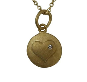 Round matte finish pendant featuring a Zirconite Cubic Zirconia in heart