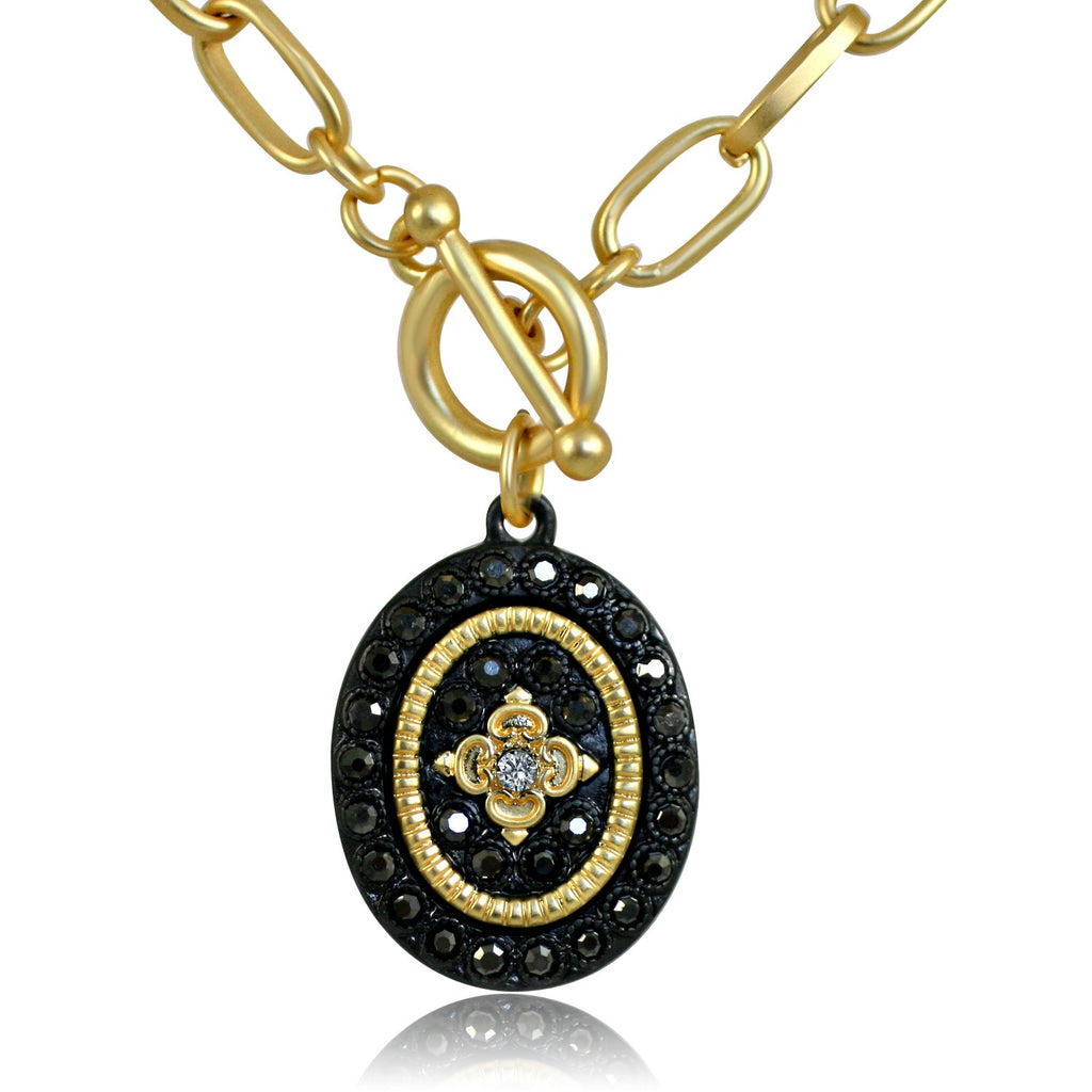 Black and Gold Oval Pendant Paved with Black Diamond Flower Design in the Center Elongated Chain Link Toggle Clasp
