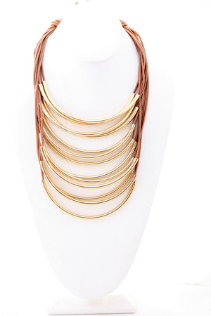 Multi strand leather cord and metal tubes draped statement necklace. 702N6214