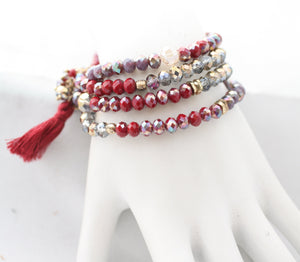 Three Stretch bracelet set made with faceted Glass beads Rundles finished with a string tassel 661B385