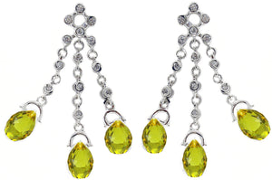 Dangling teardrop chandelier earrings with cubic zirconia round stones, finished in sterling silver.