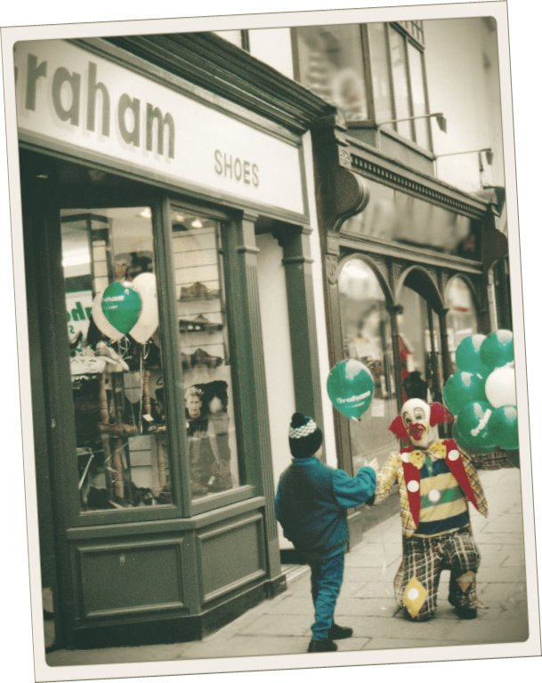 Picture of a Clown and a Boy in front of an old Graham store