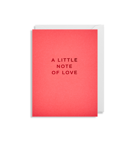 A reddish pink card with