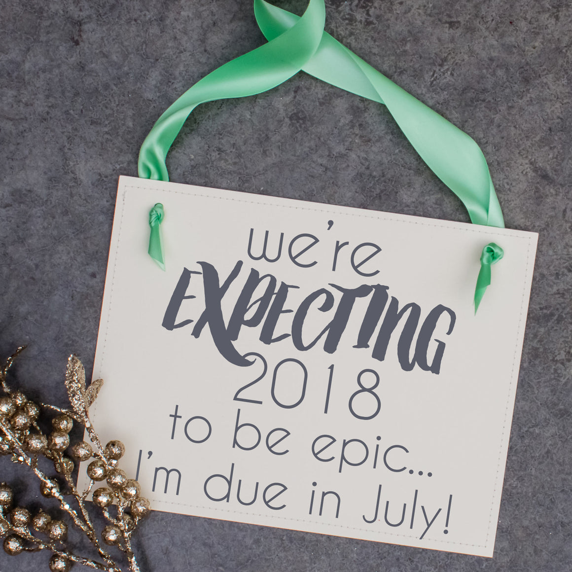 We're expecting 2018 to be epic sign baby announcement