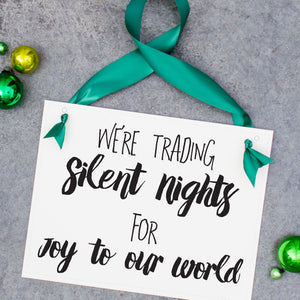 Trading Our Silent Nights for Joy To Our World Sign