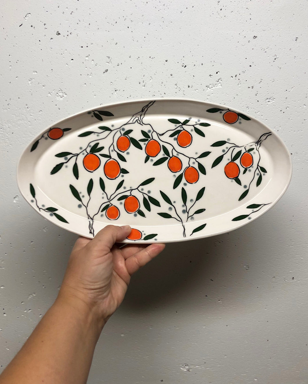 Oval platter or tray (large) - orange design on porcelain