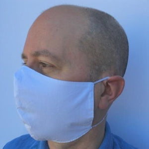 Man wearing washable and reusable 100% cotton face mask made by TheraCalm