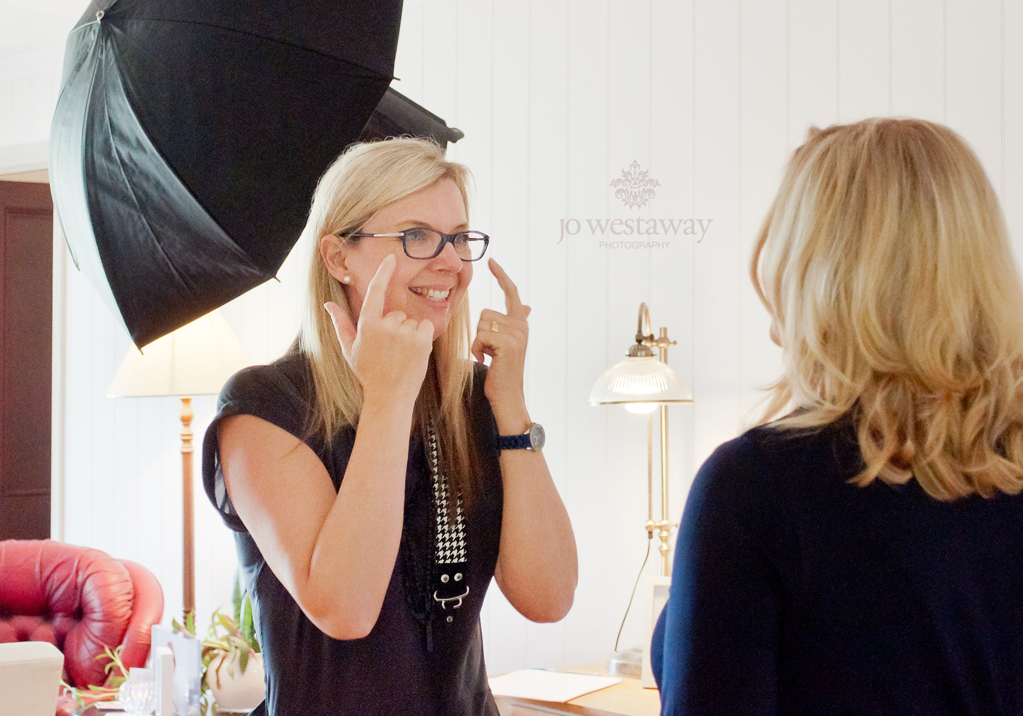 How to get a natural flattering smile in photos - professional brand photography shows her clients