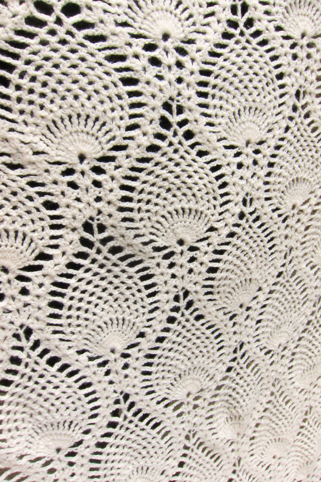 Detail of vintage off-white crochet blanket