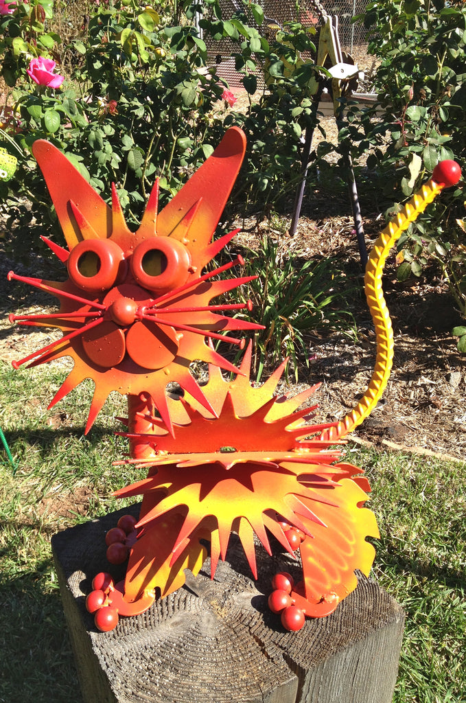 yellow and orange upcycled metal cat sculpture