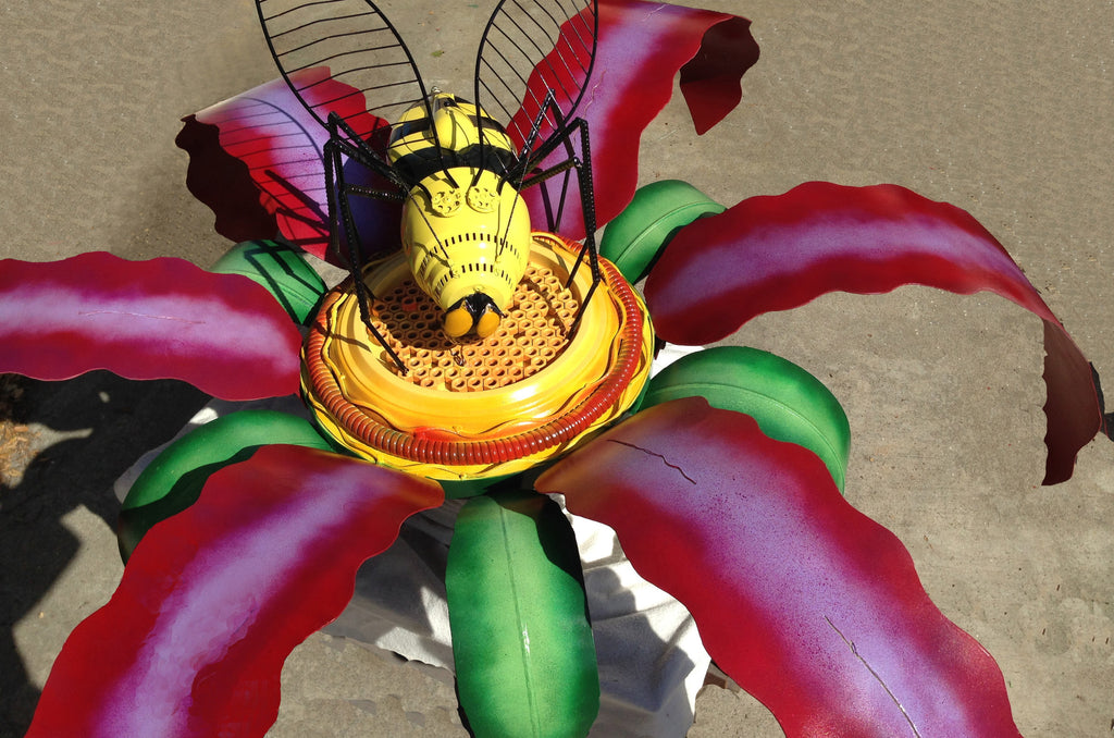 large bee and flower sculpture from reclaimed upcycled metal
