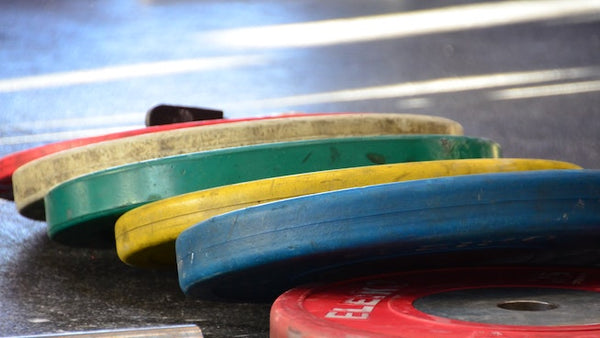A pile of various bumper plates
