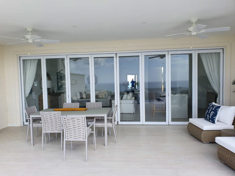 8 PANEL BIFOLD DOOR, WHITE FINISH WITH CLEAR GLASS