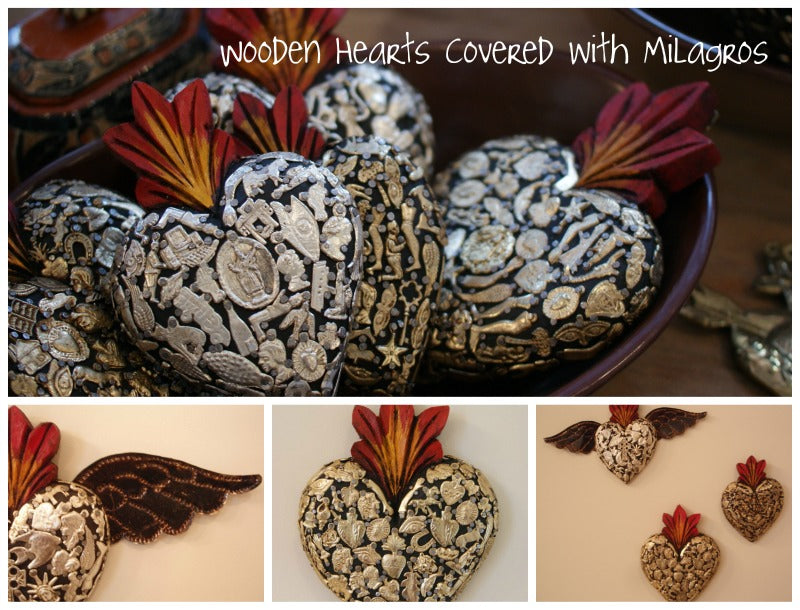 Metal milagros on wooden hearts