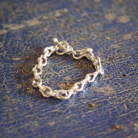 Sterling Silver Horseshoe Bracelet with Toggle Closure - Zinnia Folk Arts