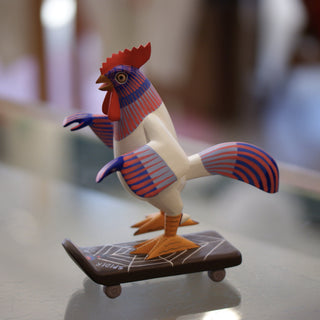 Carved and Painted Skateboard-Riding Roosters, Avelino Perez, La Unión Tejalápan - Zinnia Folk Arts